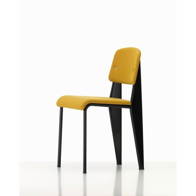 Vitra standard SR chair in canola and deep black by Jean Prouvé. The engineer and designer Jean Prouvé produced his...