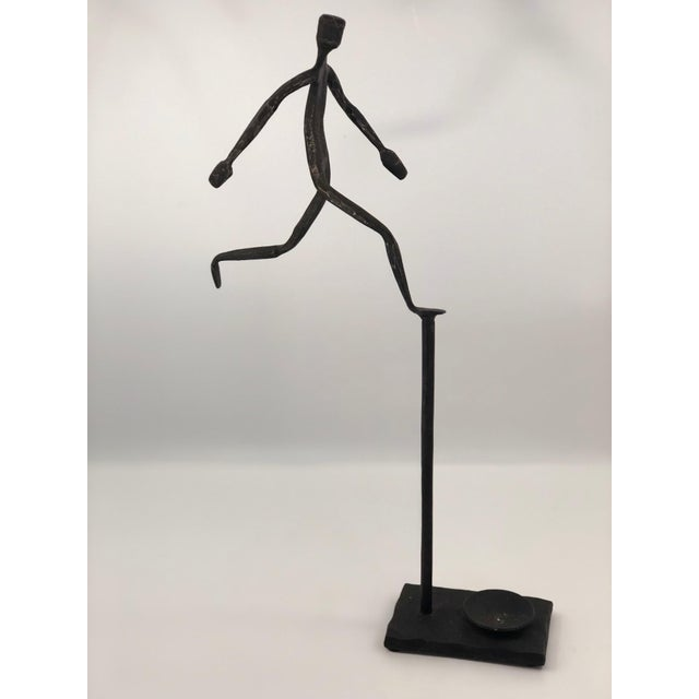 I do not know the origins of this welded iron/steel sculpture of a a man running in space, but I think it is really...