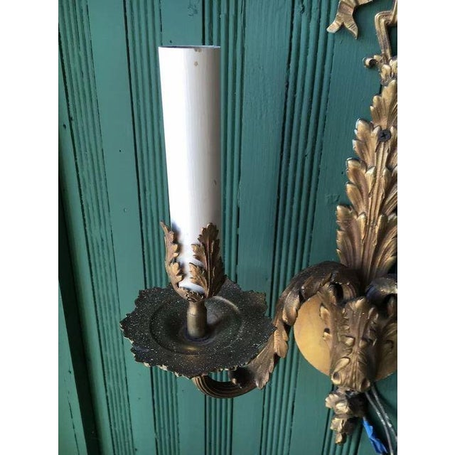 This is a fabulous set of 4 large double light matching French Louis XVI wall sconces cast in bronze and finished in gold....