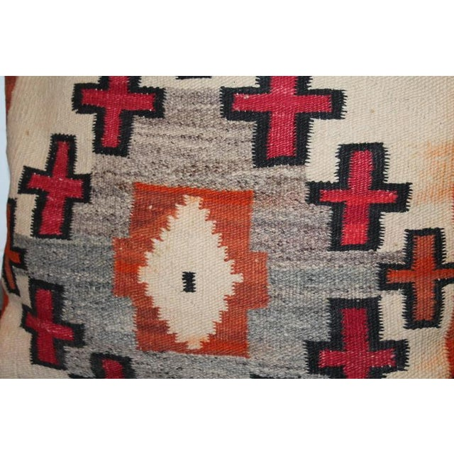 These large bolster pillows are from a early 19th transitional Navajo Indian weaving and have black cotton linen backing....