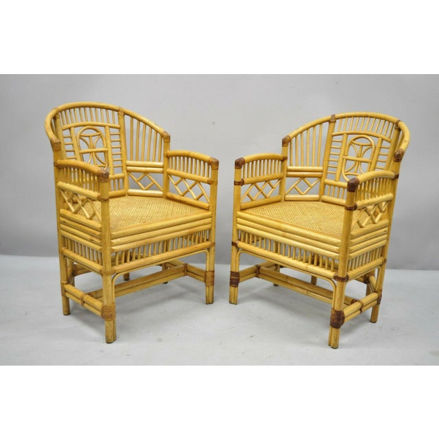 Pair of Vintage Brighton Pavilion Style Bamboo & Cane Rattan Arm Chairs (B). Item features cane seat, fretwork design,...