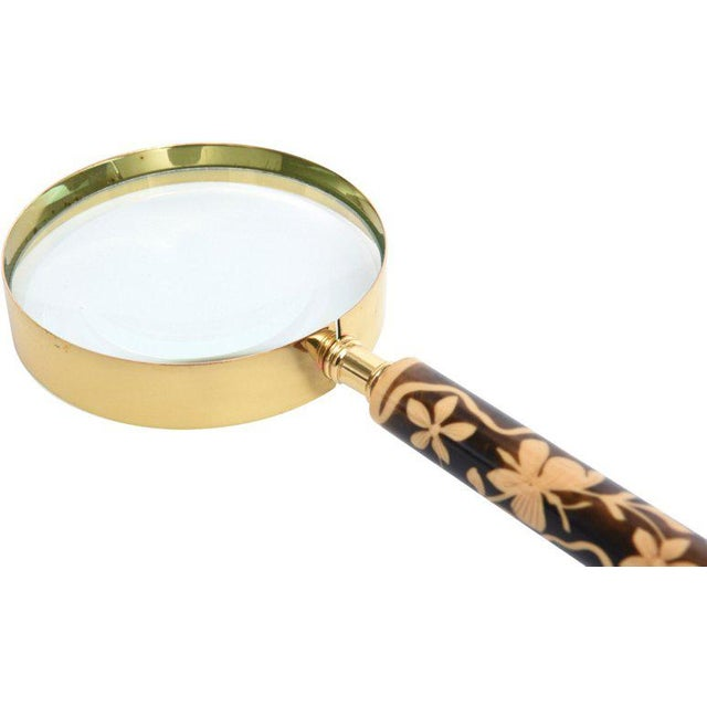 Early-20th-century Bakelite handle with butterfly and flower motif with brass-plated chrome magnifier. The magnifier...