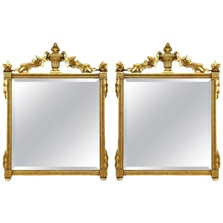 Neoclassical Style Giltwood Beveled Mirrors Decorated Urn Crest and Foliage Pair For Sale