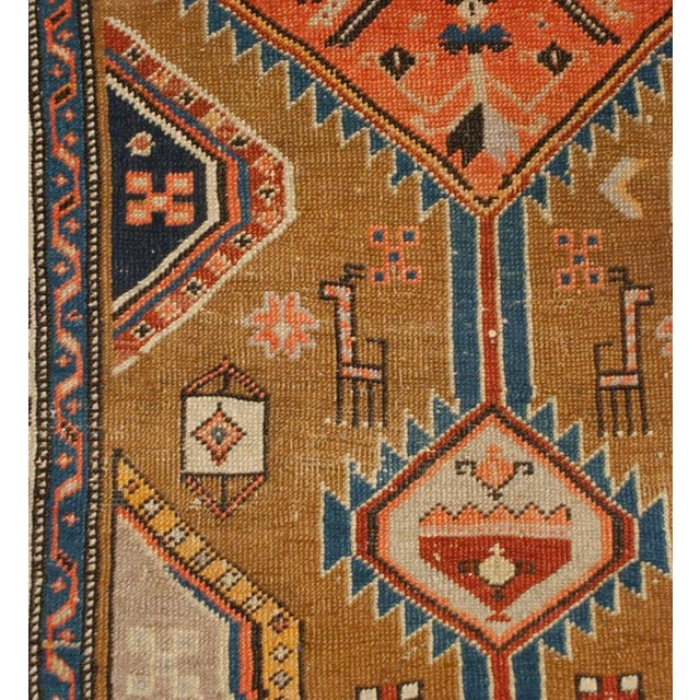 An antique, late 19th century, Persian Serab runner with multiple diamond medallions on a natural wool background...