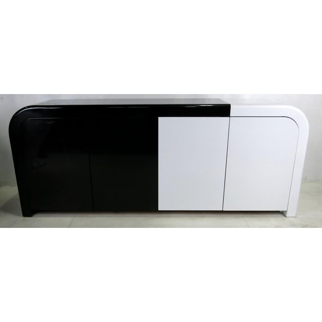 High end custom Waterfall Corner Buffet freshly refinished in a deconstructed Black and White French Polished Lacquer...