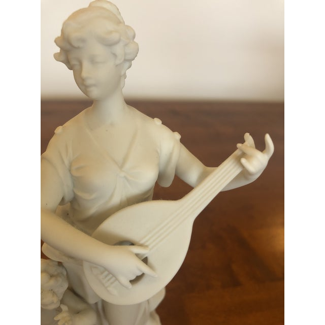 A magical antique pair of parian porcelain bisque musical maidens with impressive sculptural details. The gestures are...