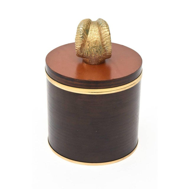 This fabulous Italian hallmarked Gucci two part round box and or humidor is a great combination of leather, wood, cork and...