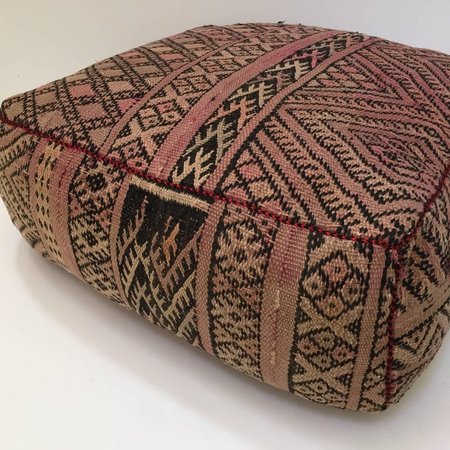 Moroccan vintage floor pillow seat cushion made from a Tribal kilim flat weave Berber rug. Square shape with nice faded...