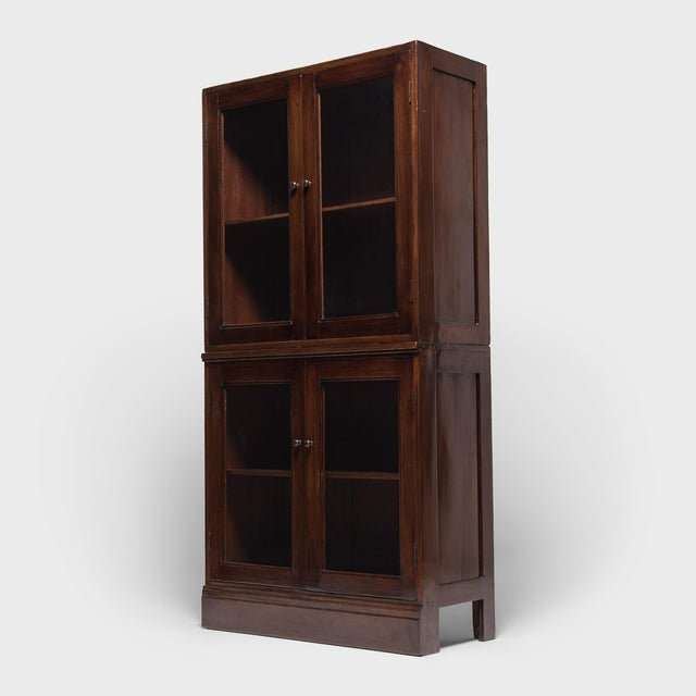 This early 20th-century teak cabinet from the northern Chinese port city of Tianjin has strong colonial influences...