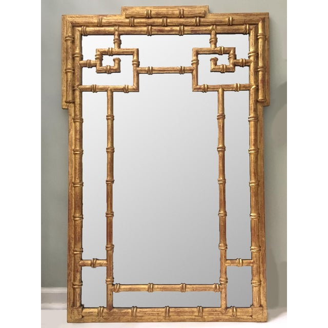 Large faux bamboo framed chinoiserie wall mirror lends just the right touch of chinese influence to your decor. Excellent...