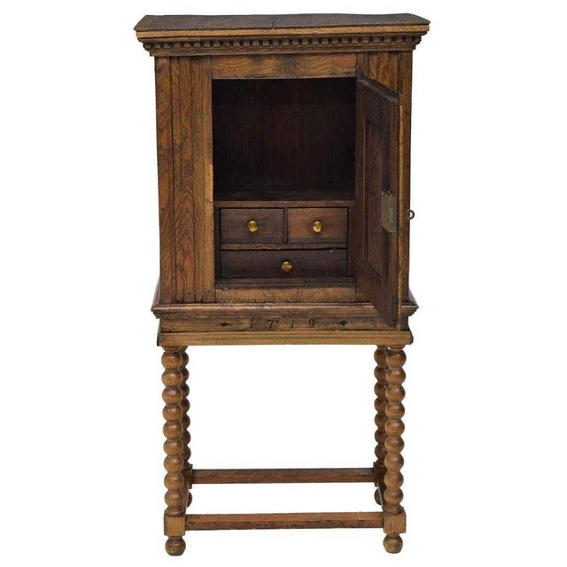This wonderful Danish Baroque style oak cabinet is fashioned from 18th century and later elements were added. The date...