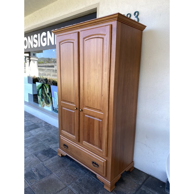 Design Plus Gallery presents a Simply Amish Cherry Wood Classic Wardrobe Armoire. Wood veneer is molded into traditional...
