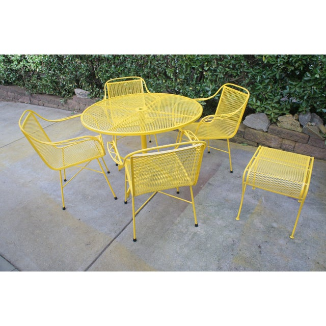 Fun midcentury modern wrought iron dining set in cheerful buttercup yellow. Features a 41.5 in round dining table with...