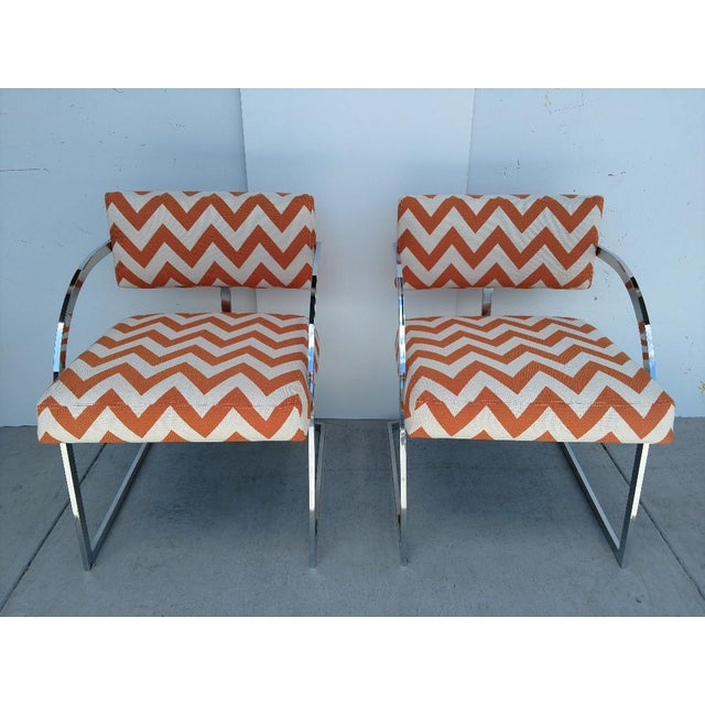 This is a great pair of vintage chrome Milo Baughman armchairs. The chairs have beautiful curved lines. The chairs are...