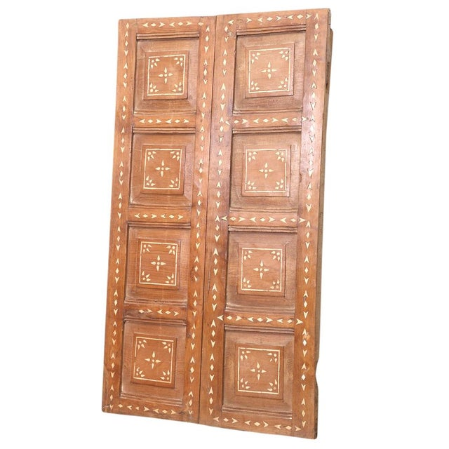 Antique Anglo-Indian door with intricate bone inlay depicting a geometric motif with a warm wax finish. Age wear, some...