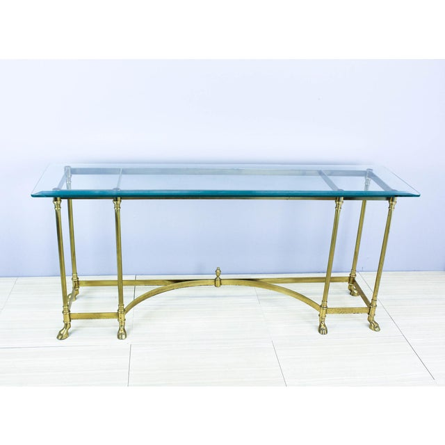 Vintage solid Italian brass console with rams hoof feet and glass top This elegant brass console will stand out in any...