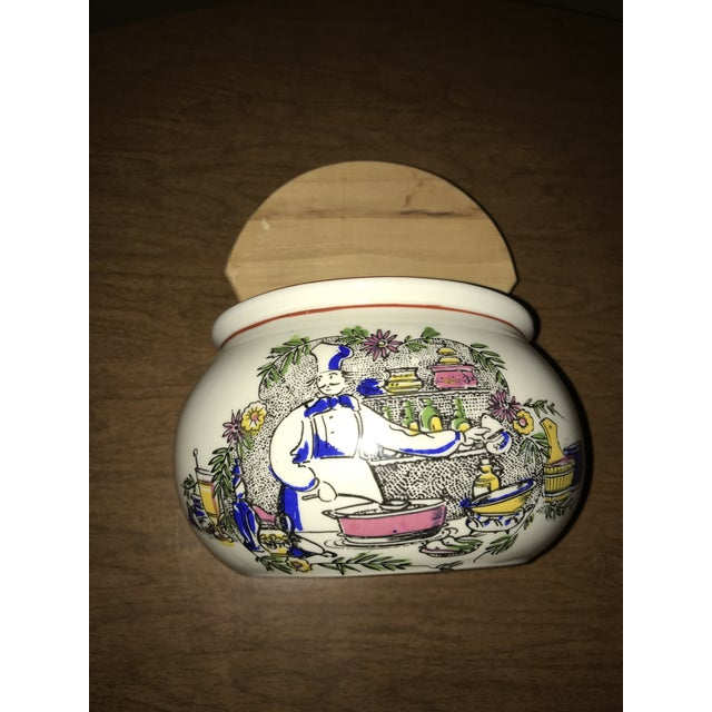 """This is a beautiful ceramic box with a wood lid . Vintage item for storing salt. Measures 7 1/2"""" tall and the box is 6"""" x 4"""""""