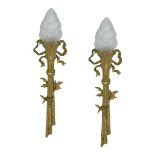 French 19th C. Neoclassical Bronze Dore Wall Lighting Torch Sconces With Louis XVI Bows with Frosted Flame Liberty Figural Shades - a Pair For Sale
