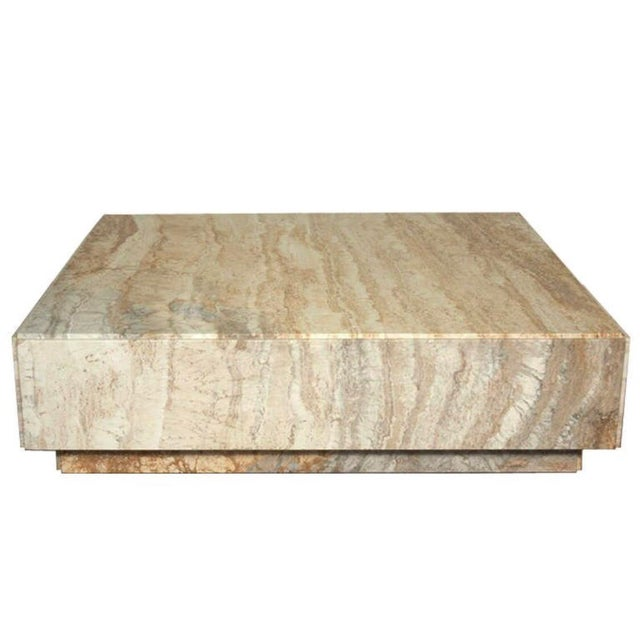 Milo Baughman's modern monolith travertine coffee table is one of the great triumphs of 20th century modern design. It is...