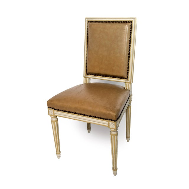 Set of four square back Louis XVI dining chairs covered in a tan leather.