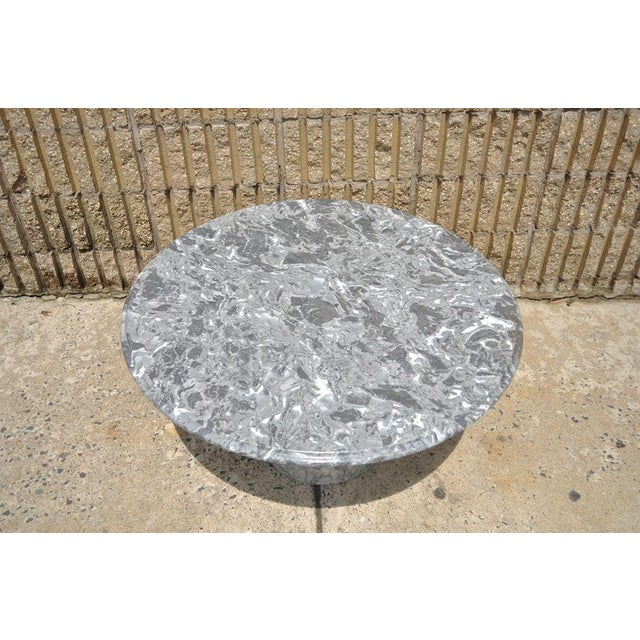Item: Vintage Mid Century Modern Italian Marble Round Pedestal Base Coffee Table. The piece features clean lines and...