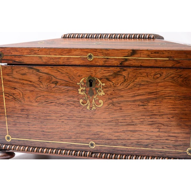C.1811-1820, Rosewood tea caddy. Lovely brass inlay accents and rosewood beading on the top and base. Interior is fitted...