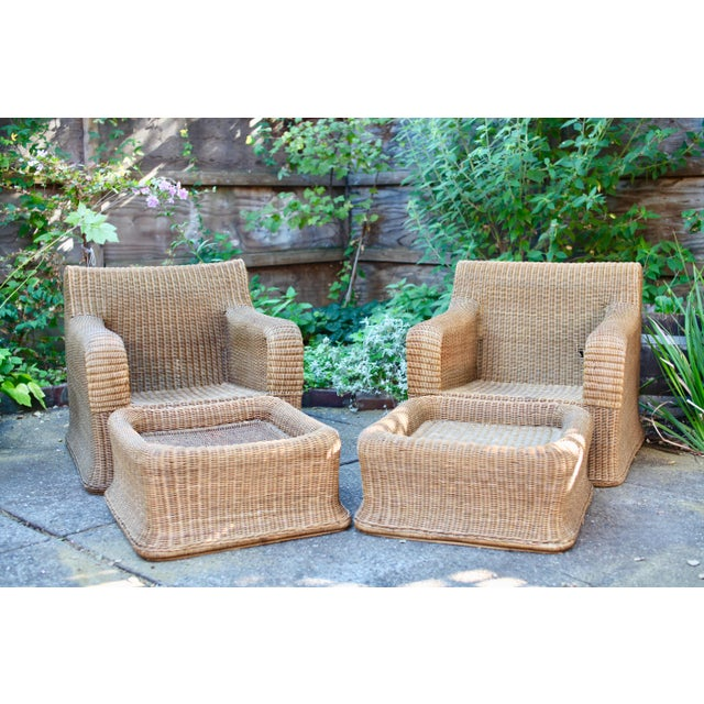 """Bamboo and rattan """"sculptural wicker"""" armchairs in the manner of Eero Aarnio or Michael Taylor, hand made in Thailand in..."""