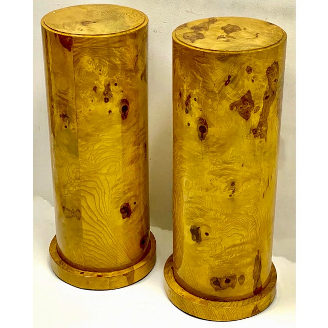 This is a pair of Italian burlwood veneer pedestals with nel-classical styling. They have a high gloss finish and are in...