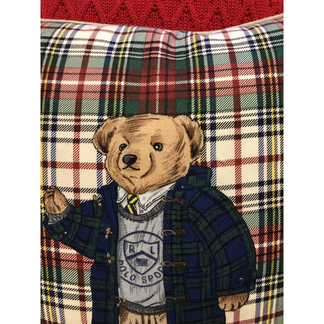 Pair of Ralph Lauren Home solid red cotton weaved pillow and classic plaid motif Polo Bear pillow. Zipper closure and...