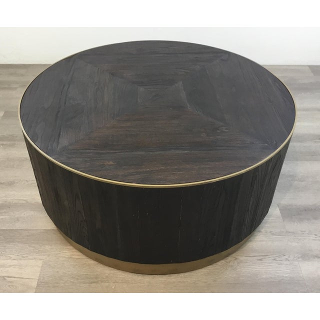 Stylish Industrial modern round wood cocktail table, brass metal band on base and top, showroom floor sample