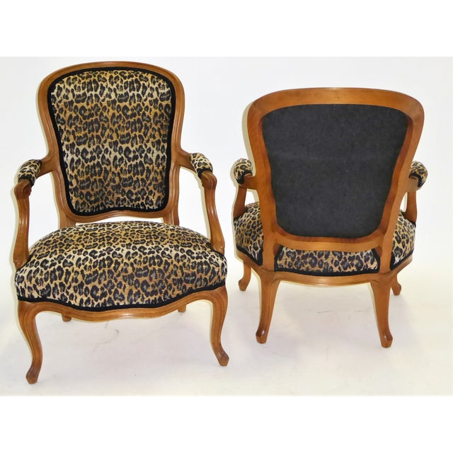 Lovely pair of Louis XV style fauteuils beautifully carved and newly upholstered in a chenille woven leopard motif in a...