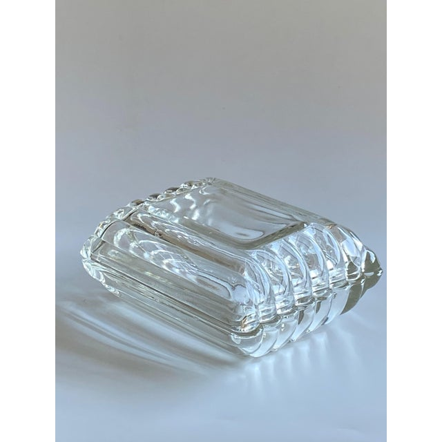 Mid century glass cigarette box is the same top and bottom can be split into two trinket or ashtrays.