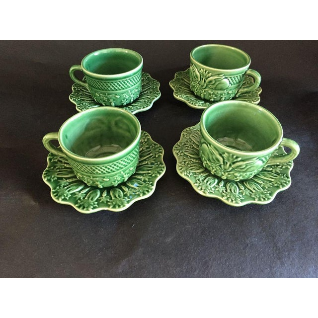 1990's Green Majolica Set of four tea or coffee cups and saucers set, with rabbits, carrots design, makers mark reads...
