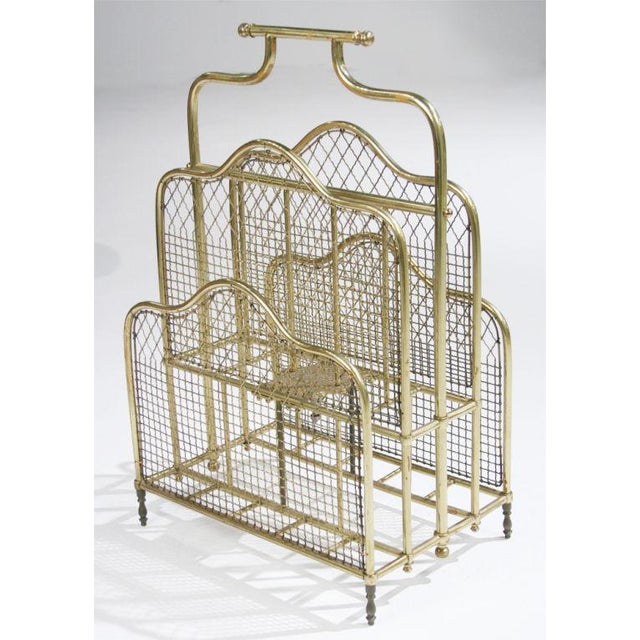 An ornate magazine stand with four compartments at two levels all resting on petite turned feet. American, late 19th century.