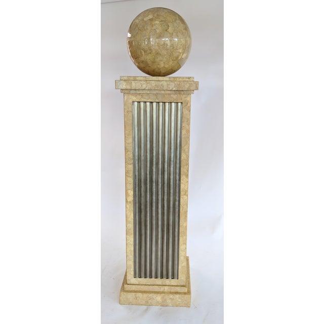 "A 16"" diameter tessellated stone ball is mounted atop the tessellated stone pillar with metallic fiberglass corrugated..."
