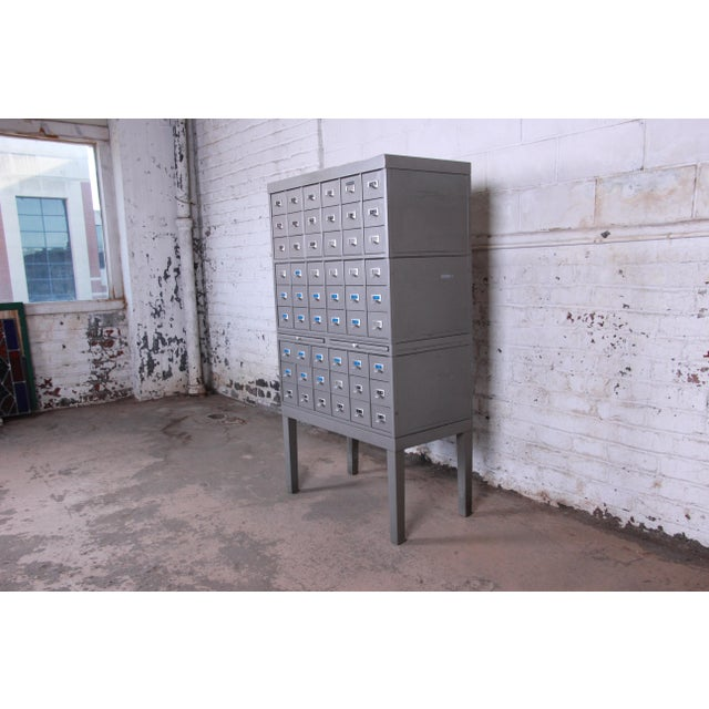 Offering a rare and unique mid-century modern industrial age metal library card catalog by Shaw Walker. The catalog...