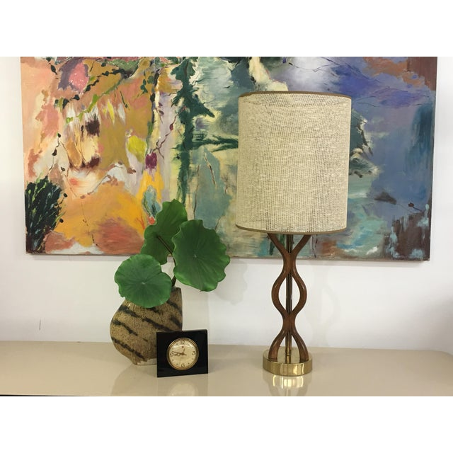 This awesome Danish table lamp is constructed of a wood body and a brass base. The shape is very interesting, three wavy...