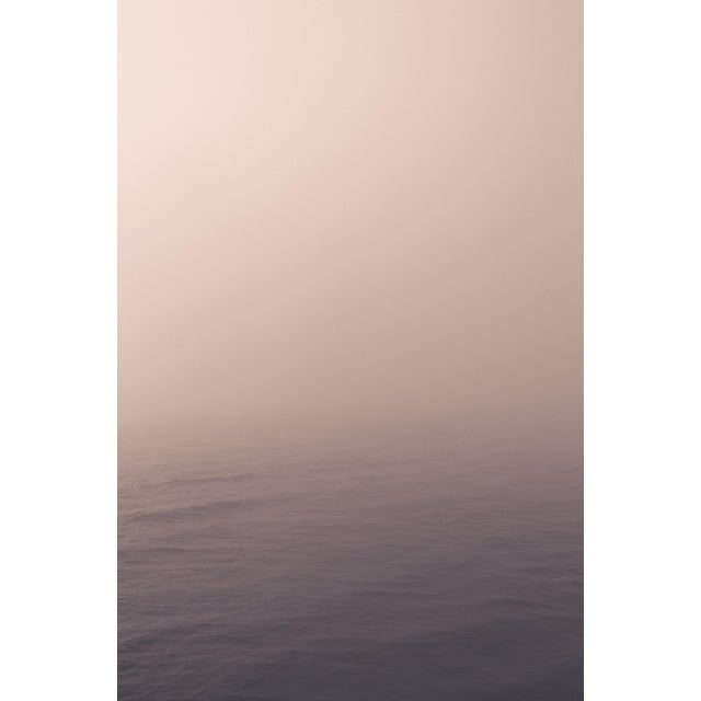 This foggy view of the Pacific Ocean has a pale palette of soft pinks and warm grey. Photograph printed on matte 100%...