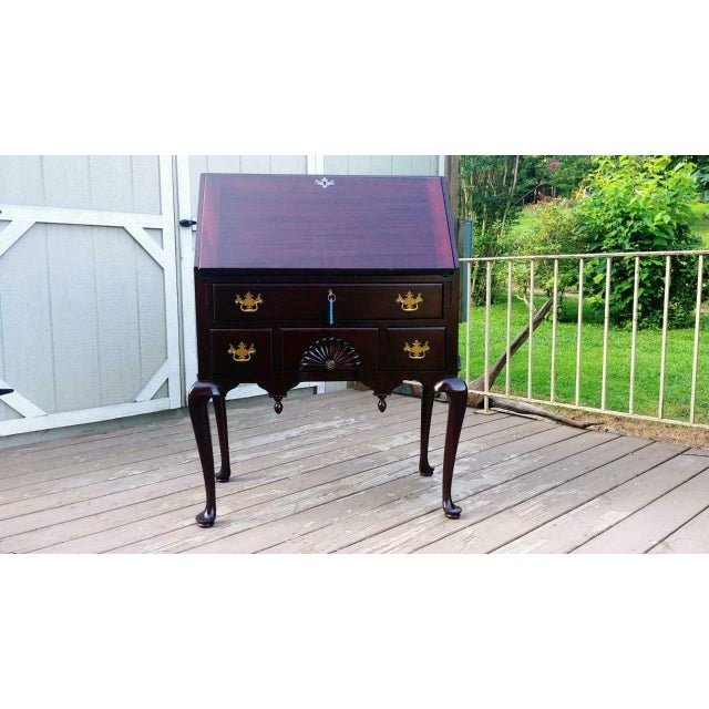 Item offered is a nicely crafted quality solid mahogany Queen Anne drop front secretary. It is all solid mahogany even the...