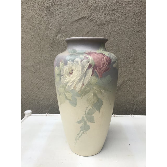 Early 20th century Weller Vase in pristine condition.Hand decorated rose detail around the whole vase. Enscized mark on...