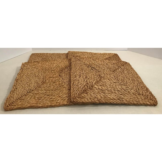 Nice set of 4 woven grass Square Placemats. A couple of the corners show wear - see pictures.