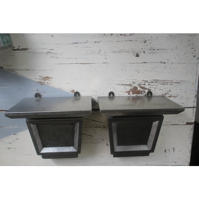 Two wood shelf brackets, antiqued silver leaf finish deep 8 inches allows for the dramatic presentation of your urn or...