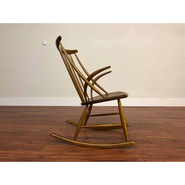 Danish architect-designer Illum Wikkelsø designed this rocking chair in 1958 and it was produced by Niels Eilersen. The...
