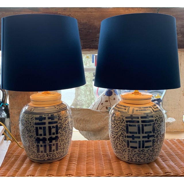 Pair of Double Happiness lamps with gold lined blue silk shades.