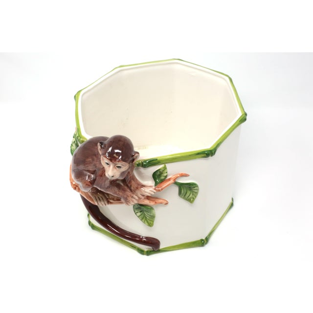 A beautiful, Italian ceramic planter with an octagonal form, it has hand-painted green bamboo design and a monkey perched...