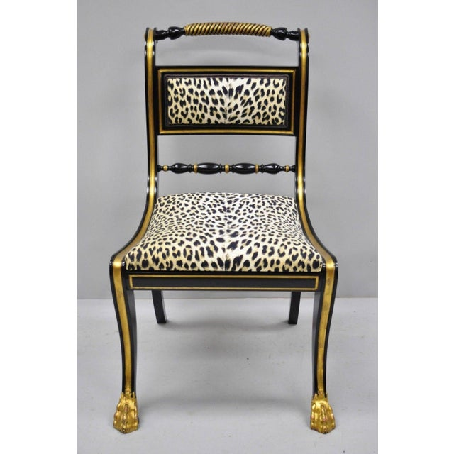 6 Black and Gold Regency Style Paw Feet Dining Chairs with Leopard Fabric. Listing airy paw feet, distressed gold gilt...