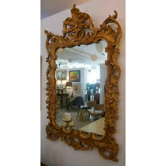 This beautiful hand carved wooden Chippendale Rococo style wall mirror is by the American firm of La Barge and was...