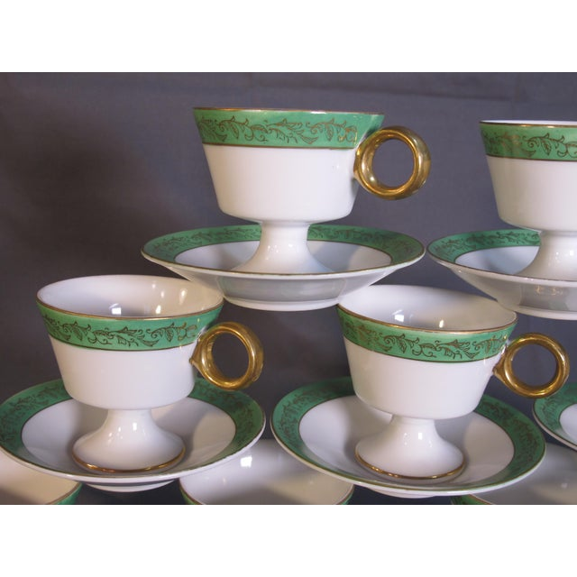 A set of elegant porcelain petit cups and saucers, marked Westchester.