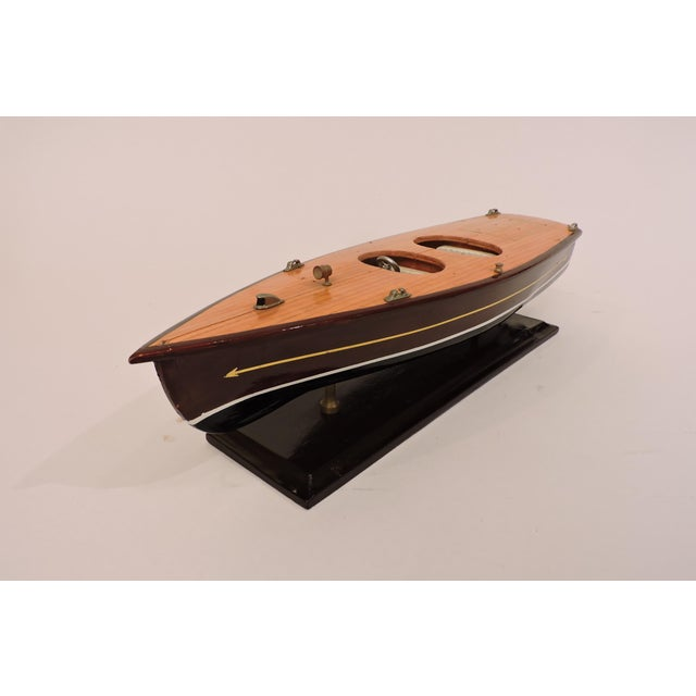 Small details like an air horn and onboard cleats add flair to this precious recreation of a mid-century speed boat. Just...