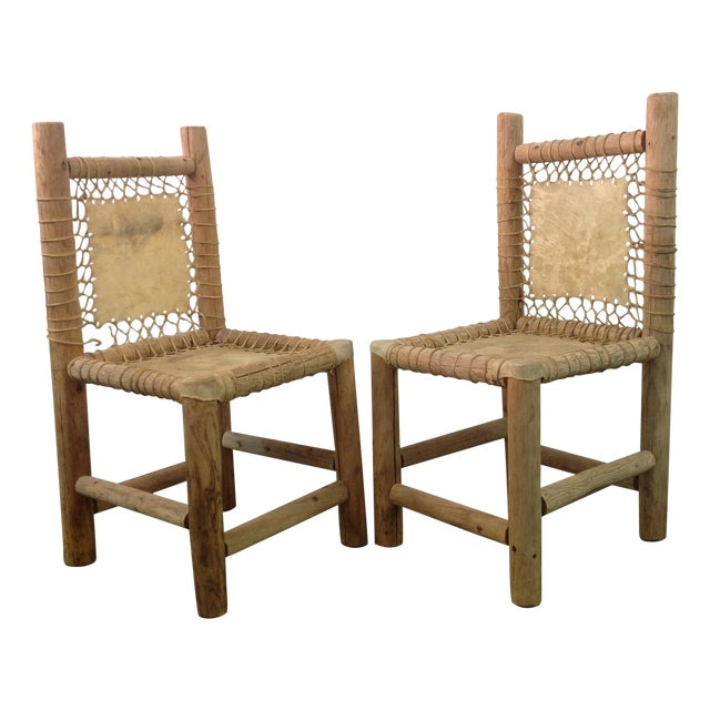 Vintage Handmade Lodgepole & Rawhide Chairs - Pair For Sale